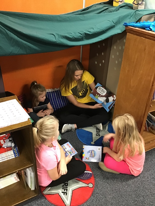 First graders take Kyley into their reading nook