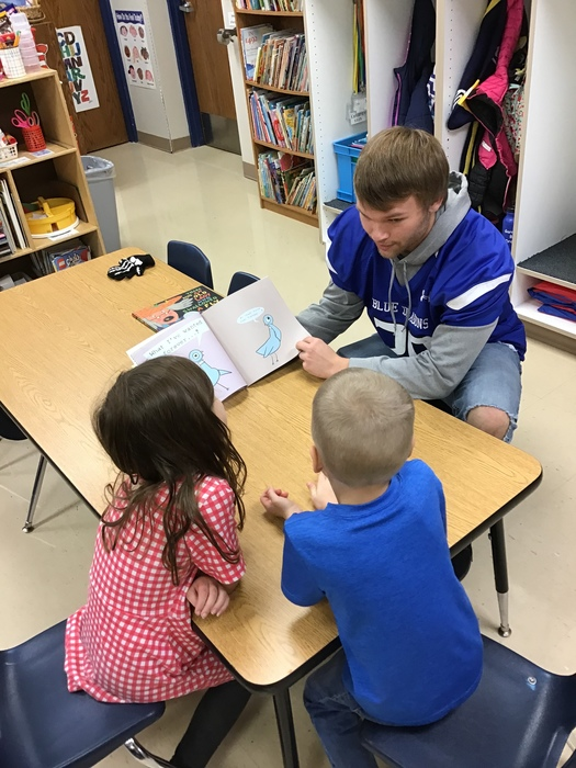 Braydon reading to the kindergartners