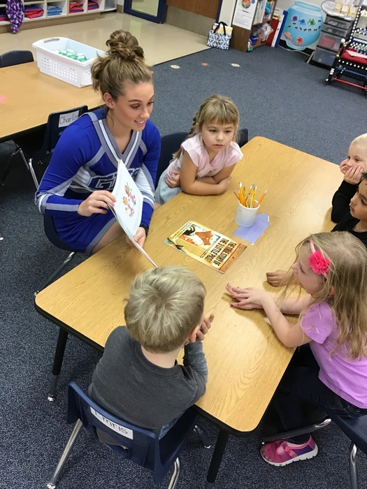 Rakell reading to K-Kids