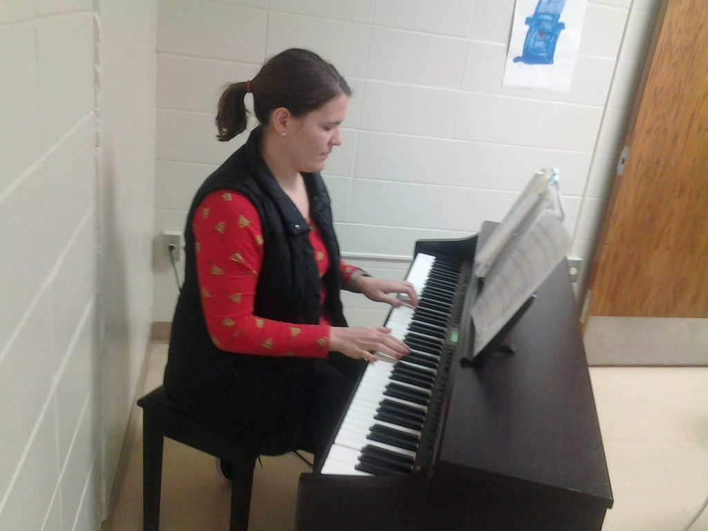 Ms. Neugebauer playing piano during lunch